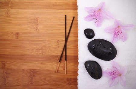 Wooden background with orchid and spa stones photo
