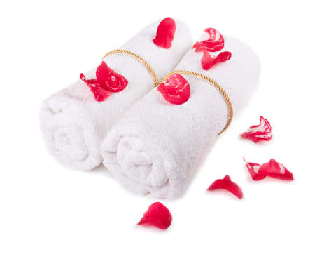 white towels with red petals isolated