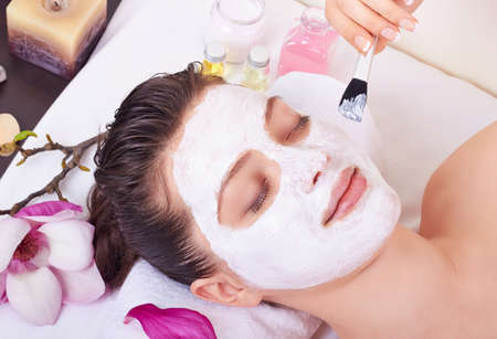 resting mask: Beauty woman getting facial mask