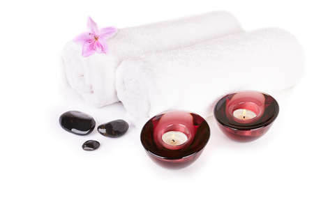 Spa and wellness setting with natural stones, candles and towel isoleted   photo