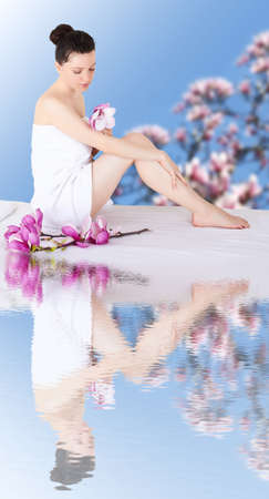 beautiful woman in spa environment Stock Photo