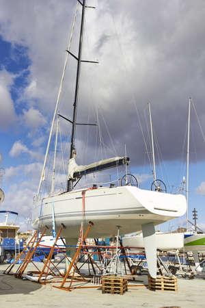 rustproof: Boat repairs in piere, summer day