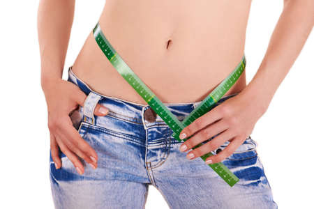 woman measuring waist: Slender hips on white - losing weight Stock Photo