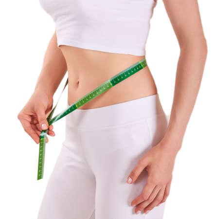 woman measuring waist: woman measuring her waist Isolated Stock Photo