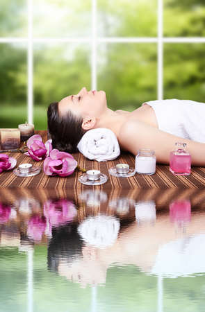 young beautiful woman in spa photo