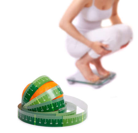 bathroom scale: Weight loss  Girl on a bathroom scale - Isolated