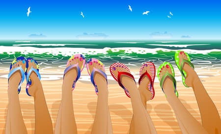 Female legs in colored flip flops against the sunny beach