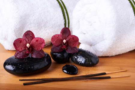 Spa stones and orchids photo
