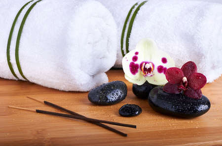 Spa stones and orchids on the wooden background  photo
