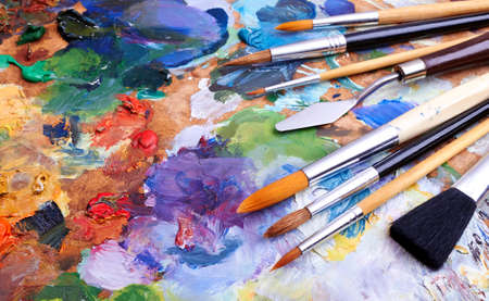artists brushes and oilpaints on wooden palette