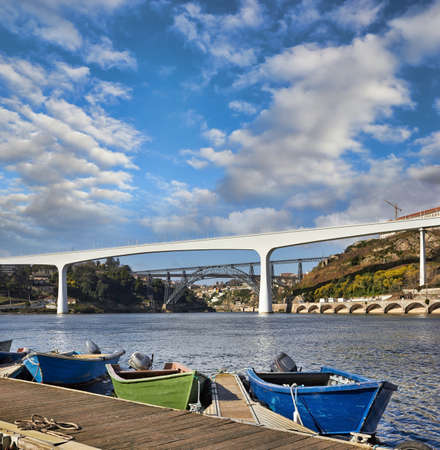 Boats on Douro river and bridges in Porto, Portugal  photo