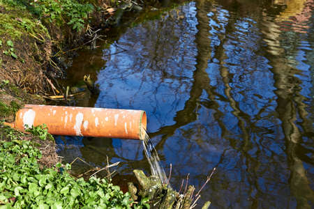 dumping: Industrial Pipe Dumping Waste Water Into The river