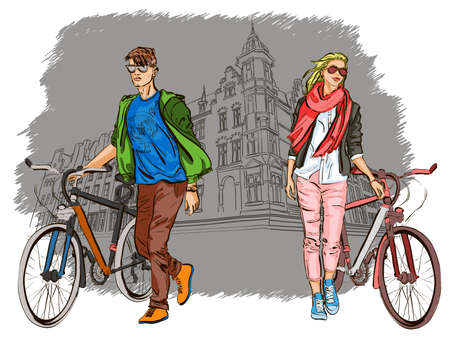 girls having fun: Young couple with bicycles on city background