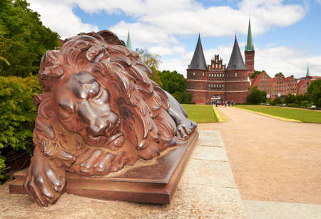 schleswig holstein: Lion statue and Holstein Gate at Lubeck  Germany  Editorial