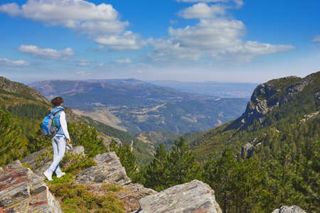 enjoying view from top of a mountain on a rock in the National Park in Portugal photo