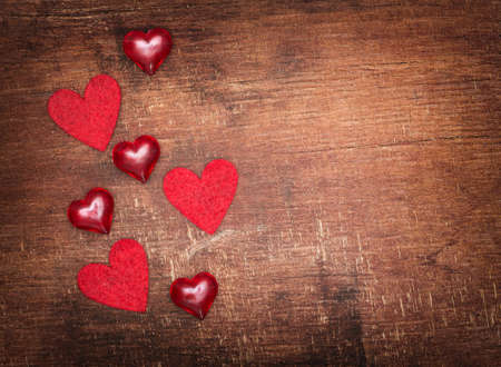 red hearts on old shabby wooden background photo