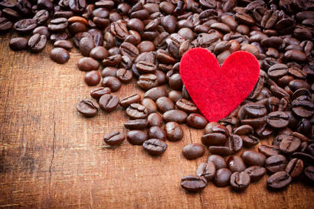coffeetree: Red heart and Coffee beans on wood background Stock Photo