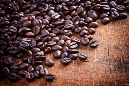coffeetree: Coffee beans on old wood background Stock Photo