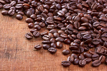jamoke: Coffee beans on old wood background Stock Photo