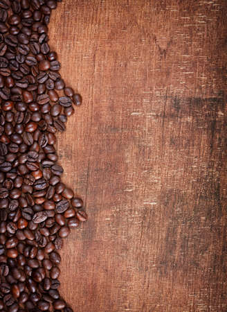 coffeetree: wood background with Coffee beans on it