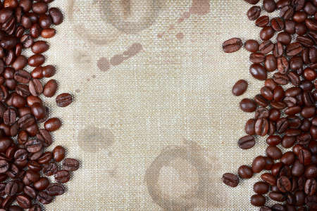coffee stains: coffee beans and burlap with coffee stains and rough edges