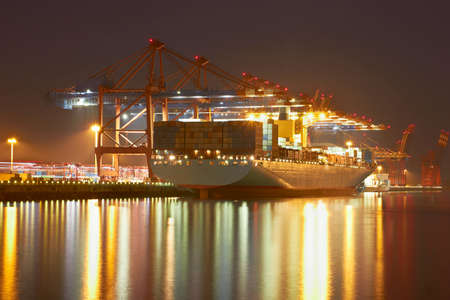 harbour: Container cranes in Hamburgs harbour, ship offloading, Germany Stock Photo