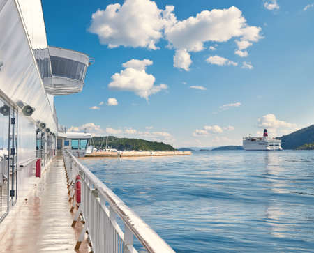 ferries: Ferries in a sunny day, landscape of Southern Norway