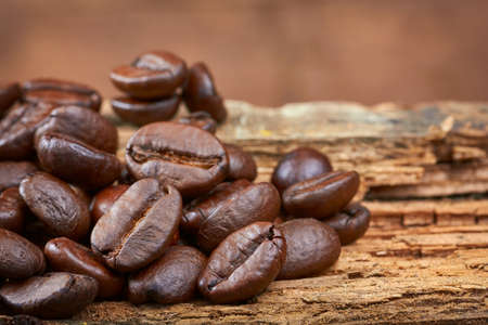 coffeetree: Coffee beans on wood background. Close-up