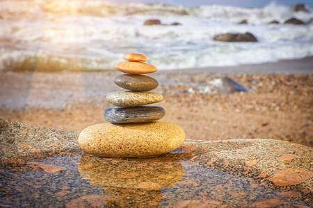 Zen Balancing Pebbles on Beach, Peaceful Concept