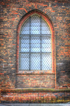 building structures: View of an old window to church in Lubeck, Germany