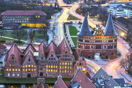 Holstentor Gate during twilight. View over the city, Lubeck, Germany