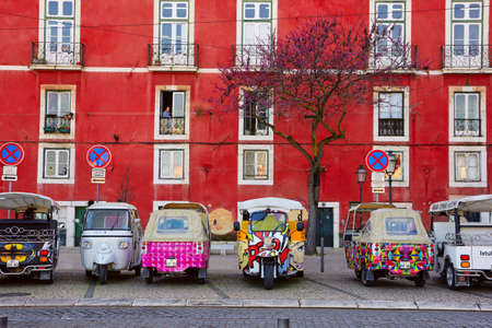 LISBON, PORTUGAL - MARCH 15, 2017: Tuk-tuk in Alfama, Lisbon, Portugal on March 15, 2017 Editorial