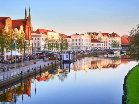 trave: LUBECK, GERMANY - APRIL 9, 2017: Historic buildings reflected in Trave river, old town Lubeck, Germany on April 9, 2017 Editorial