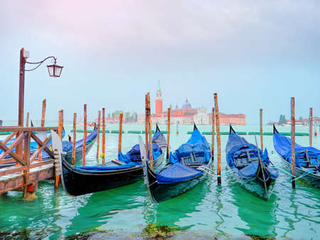 unesco: Panoramic view of traditional Gondolas on Canal Grande with San Giorgio Maggiore church