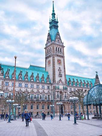 HAMBURG, GERMANY - APRIL 8, 2017: Famous Hamburg town hall with dramatic clouds, market square near lake Binnenalster in Altstadt quarter, Hamburg