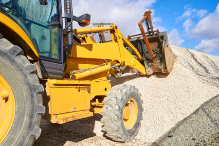 Excavator on a construction site. Heavy industry machine Stock Photo