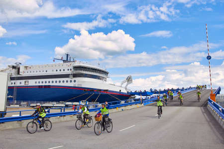 DENMARK, HIRTSHALS- JUNE 05, 2013: Cyclists disembarkation from ferry
