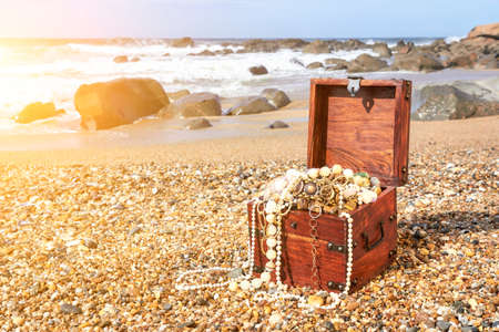 Treasure chest on the ocean beach Stock Photo