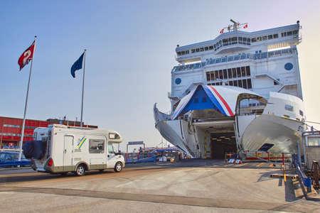 DENMARK, HIRTSHALS- JUNE 05, 2013: Tourist bus rides into the ferry.