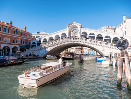 Historical ancient Grand Canal in Venice. Boat traffic