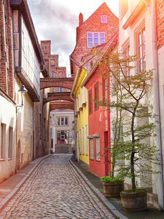 Old Lubeck street view. Small trees growing in pots. Germany