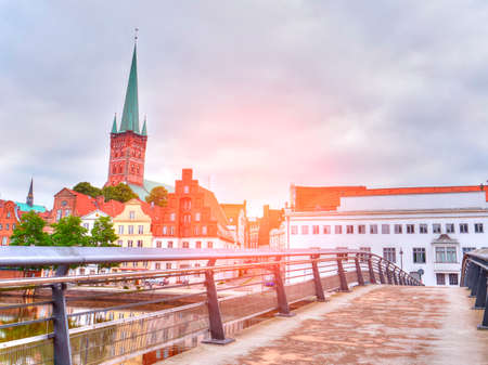 Pedestrian Bridge across Trave river in Lubeck city. Germany