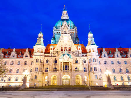 New Town Hall Neues Rathaus with lights at night. Front view.
