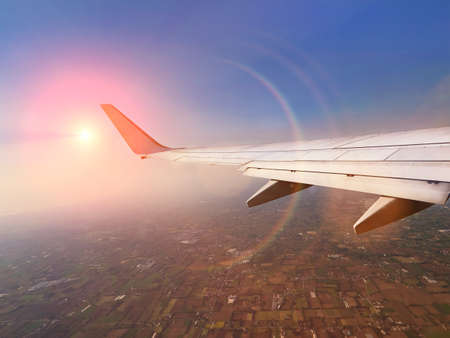 Aircraft wing in front of sky during a fly.