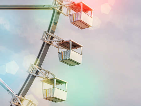 Low angle view of ferris wheel cabins.
