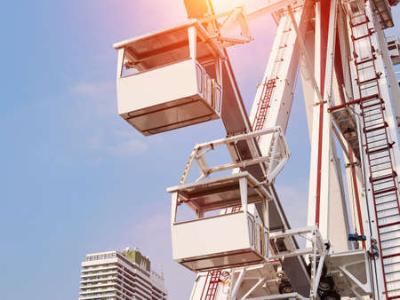 Ferris wheel cabins view. Blue sky background Stockfoto