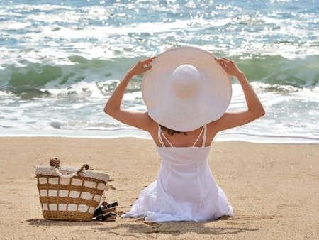 Beach vacation, woman on sand beach