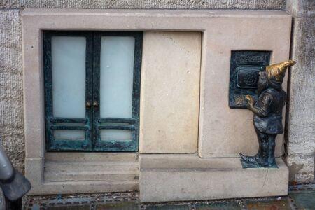 Dwarf on the street corner - Wroclaw, Poland