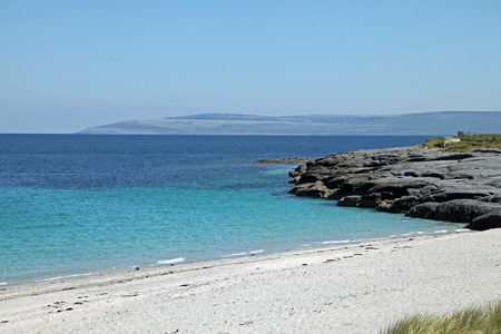 Wide white sandy beach Stock Photo