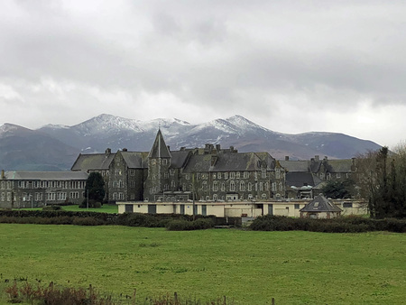 Snow capped mountains in the background of historical buildings Editorial
